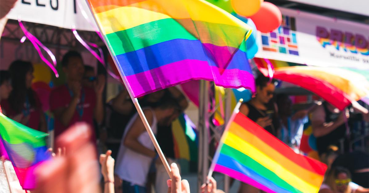 Several pride flags waving.