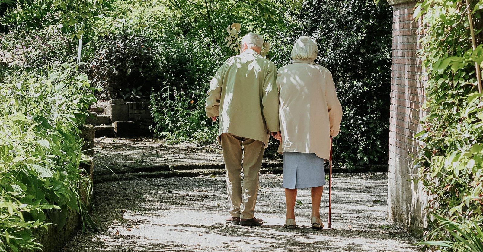 Older couple walking on sidewalk